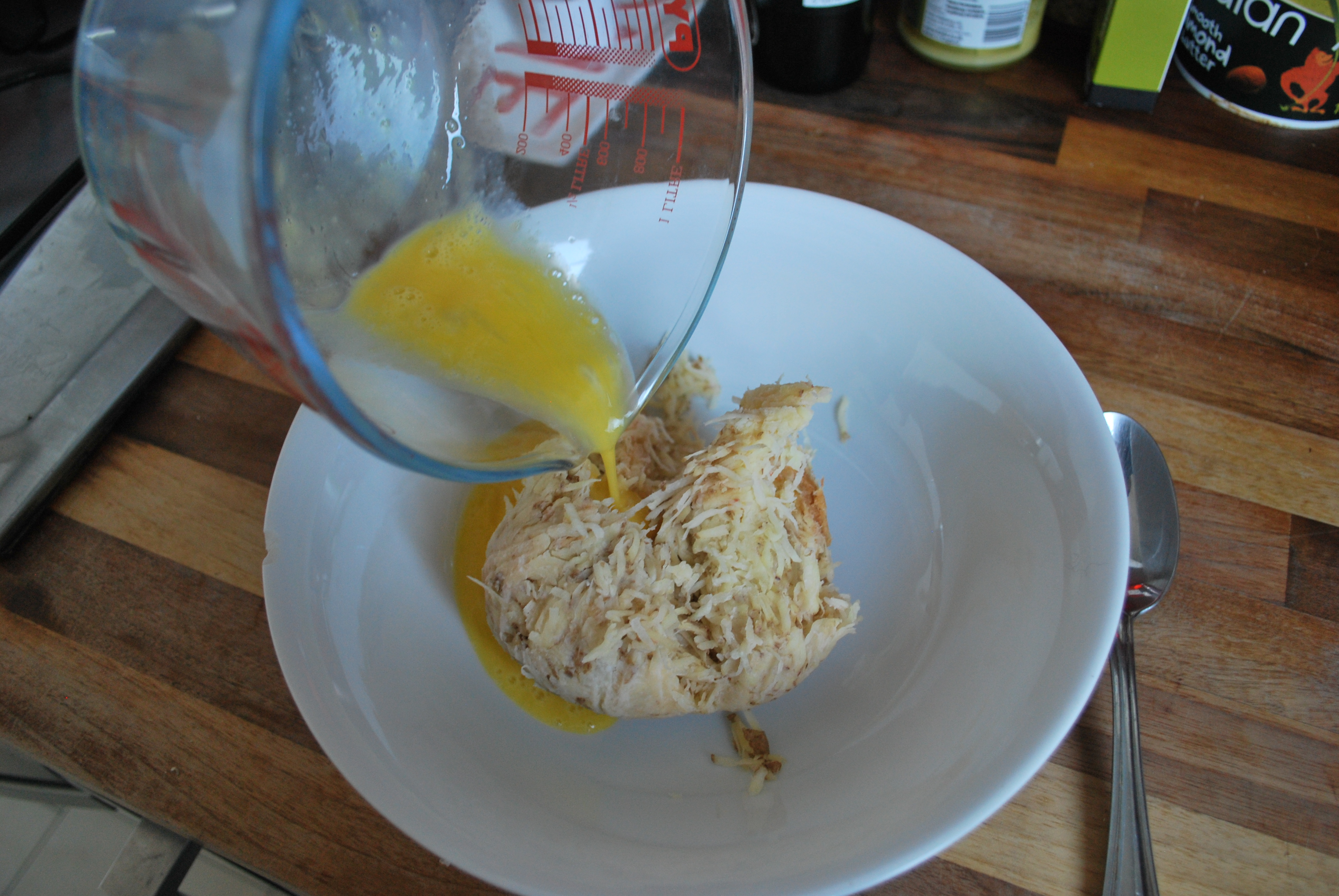 adding-the-egg-to-the-latke-mixture